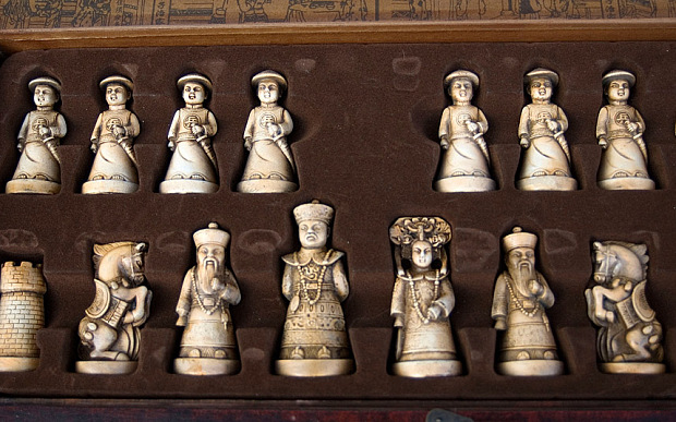 Ivory chess figurines at the Panjiayuan Market. Beijing. China